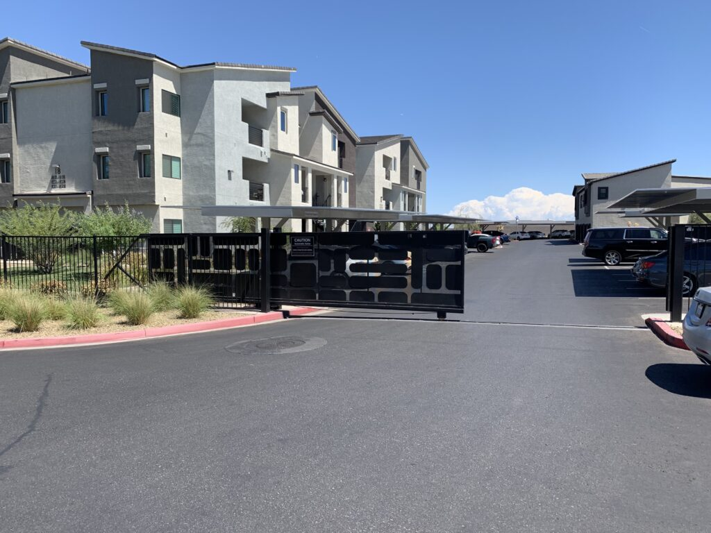 Black Security Gate with various sized rectangles with rounded corners arranged geometrically on the front face of the gate in an apartment community