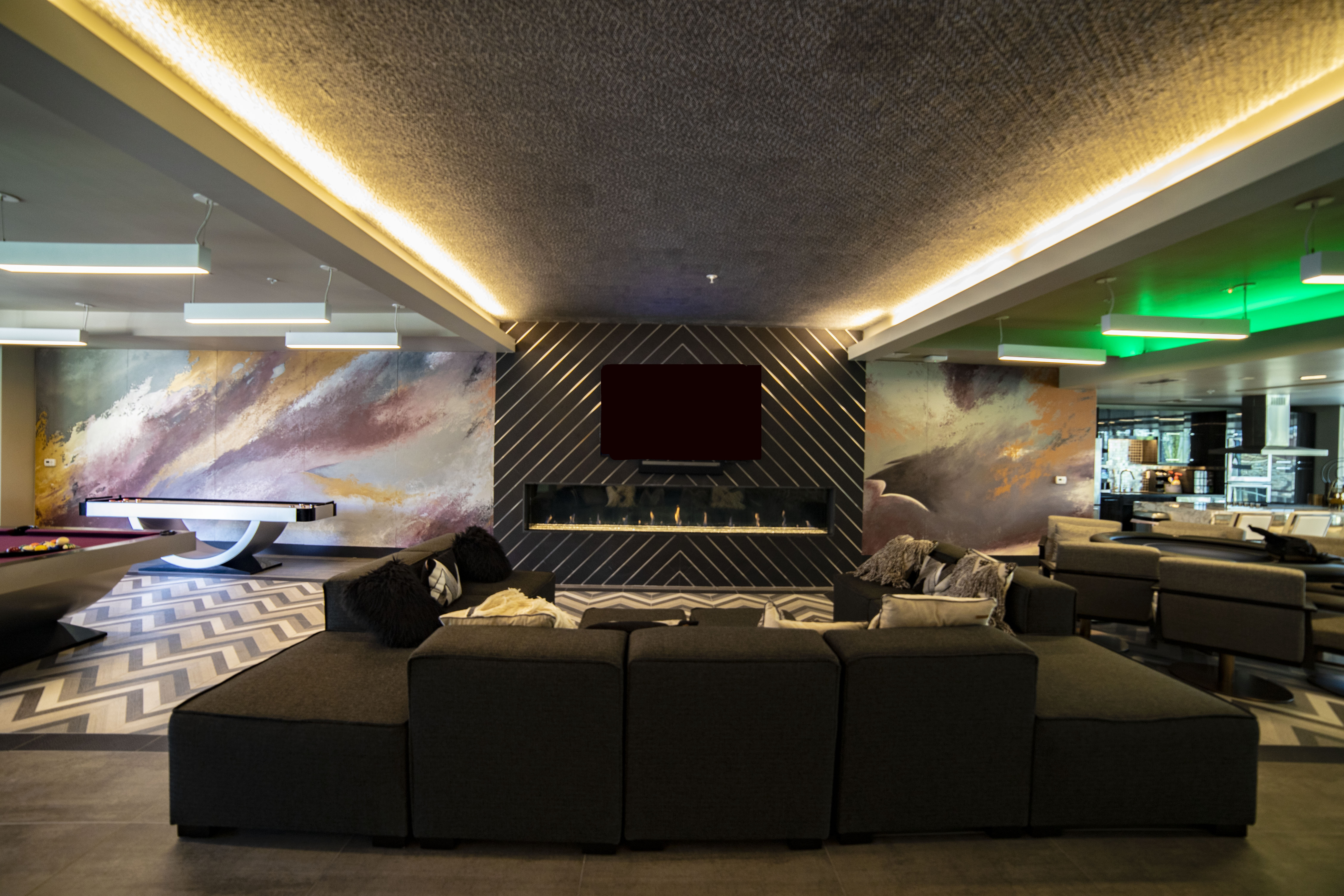 large linear fireplace with color changing capabilities in Las Vegas modern condo clubhouse