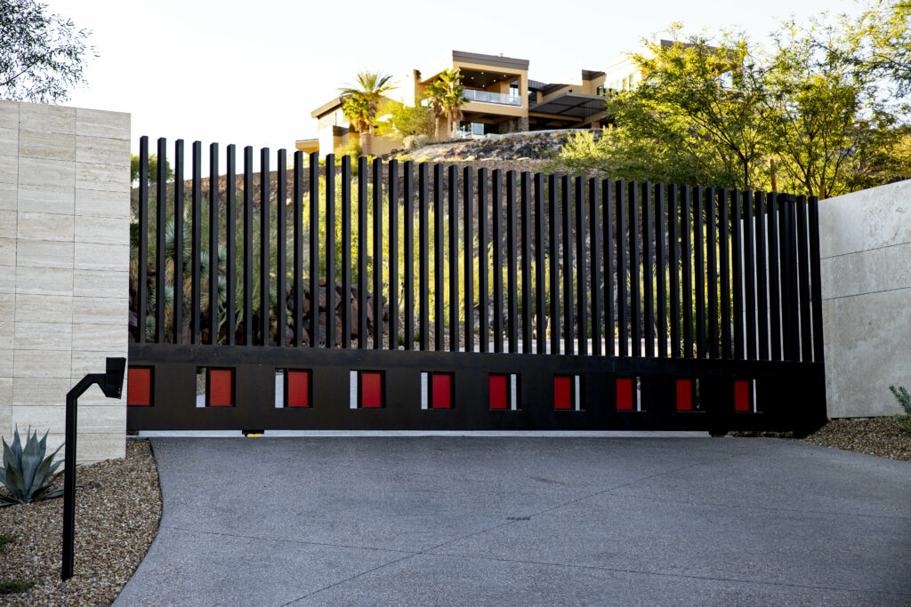 Black gate with red accent panels