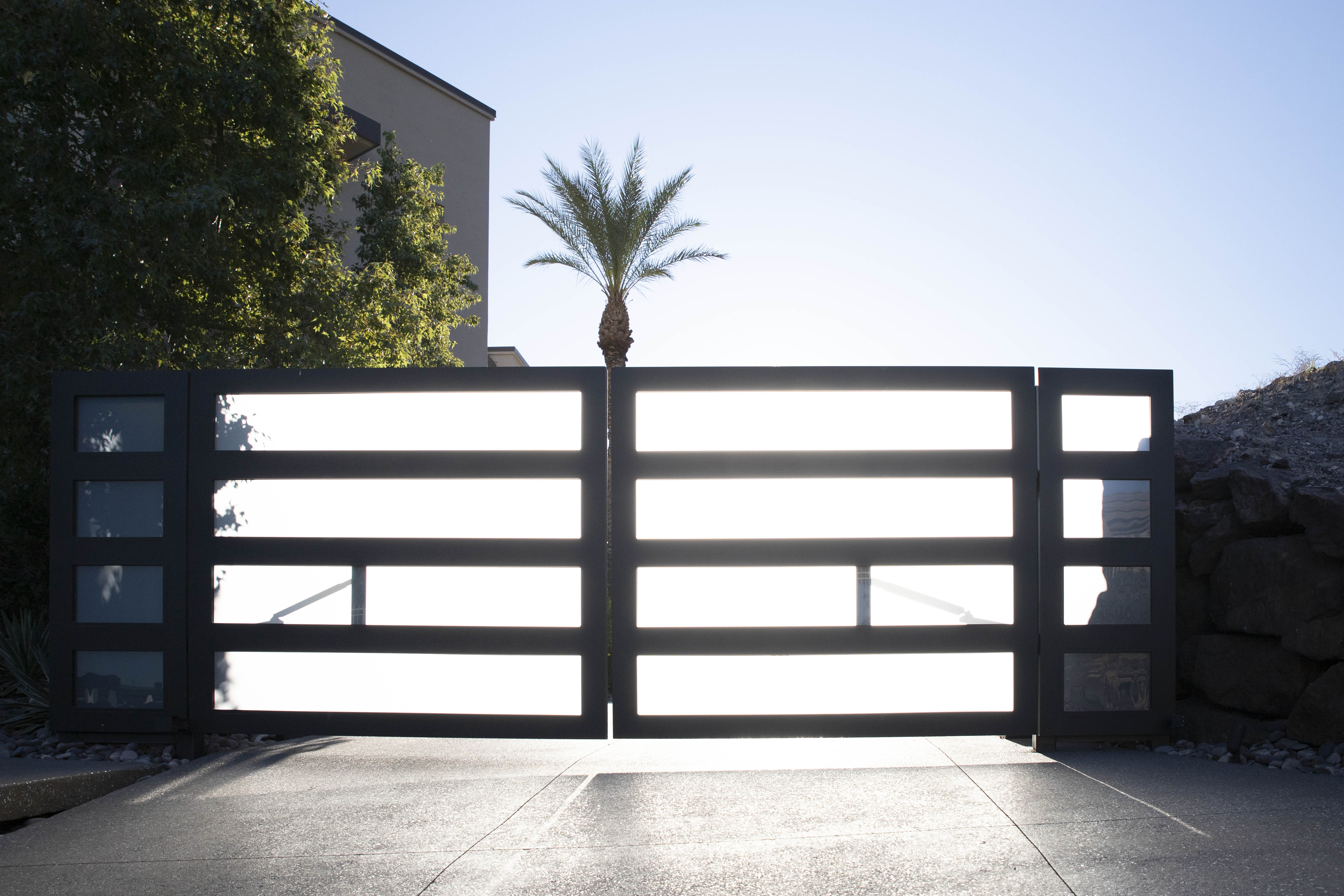 Opaque gate lets the light through and provides privacy