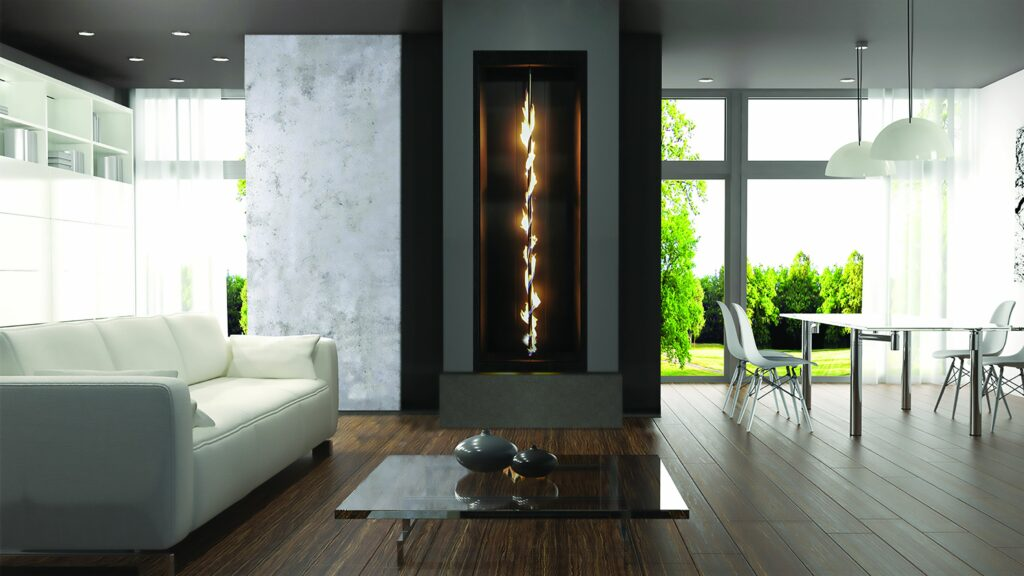 vertical pole with gas flames winding up in a large glass enclosure